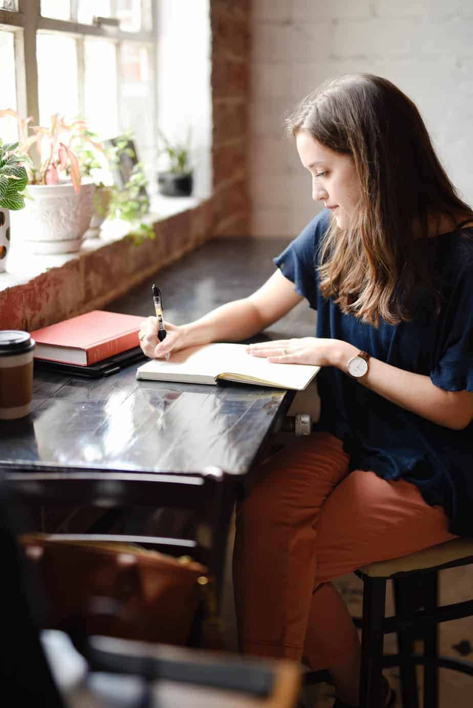 Woman writing down goals