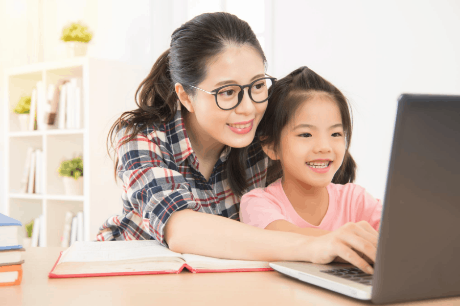 mom and daughter on a laptop