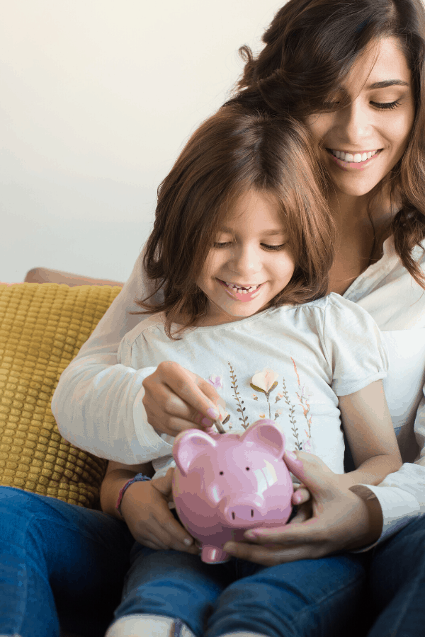 mother and child saving money