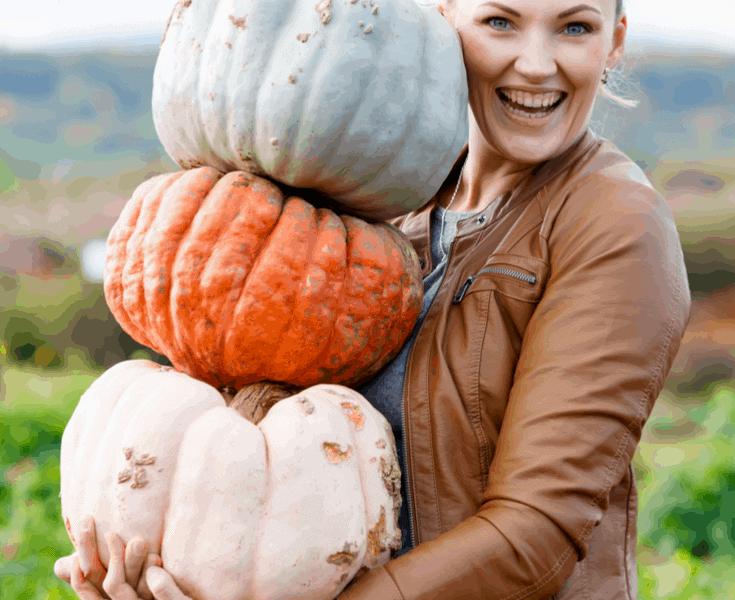 woman holding pumpkins