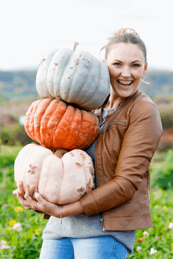 woman holding pumpkins