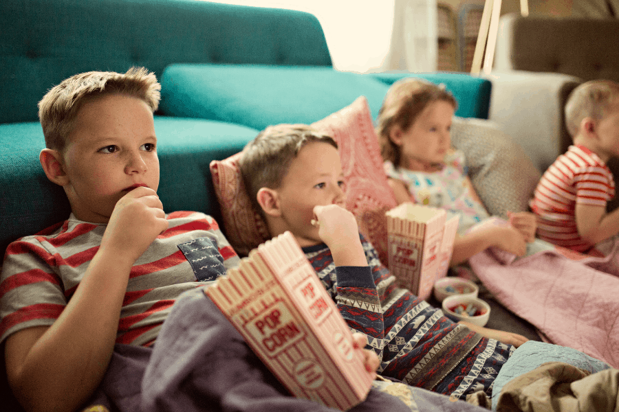 kids watching a movie at home