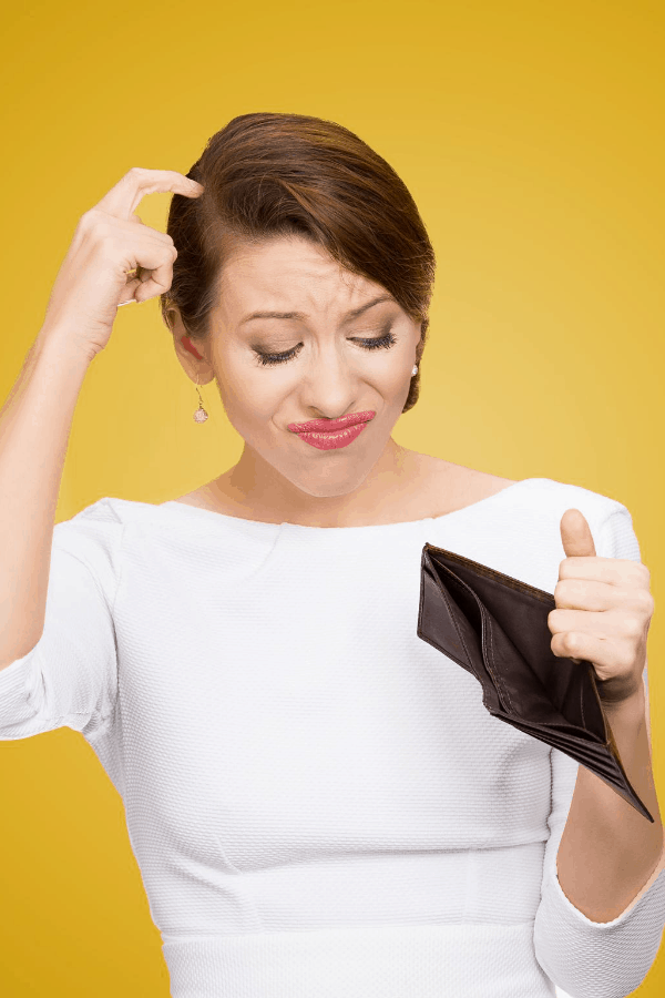 woman looking at an empty wallet