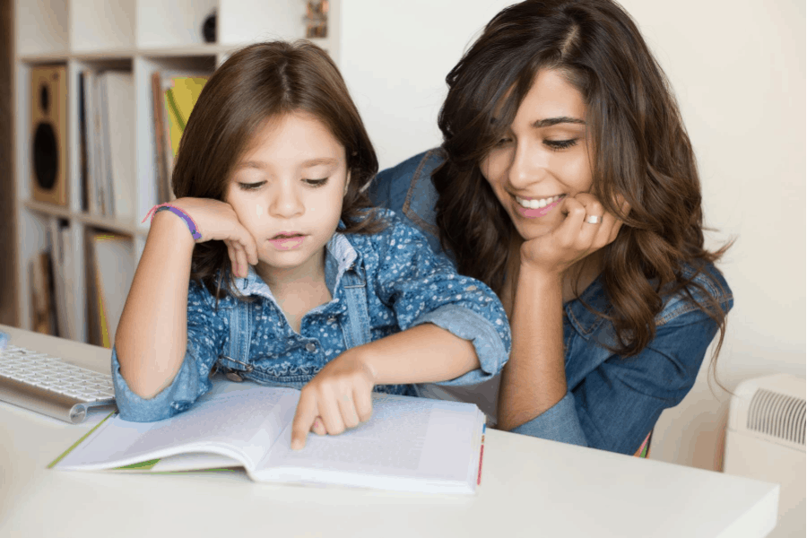 woman and daughter homeschooling