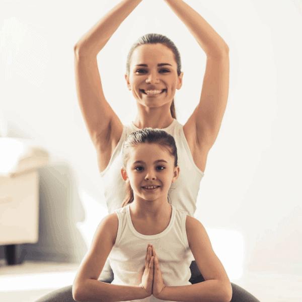 mom teaching kids yoga